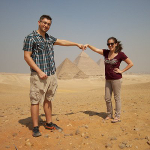 Sondra and Jeremy in front of a pyramid