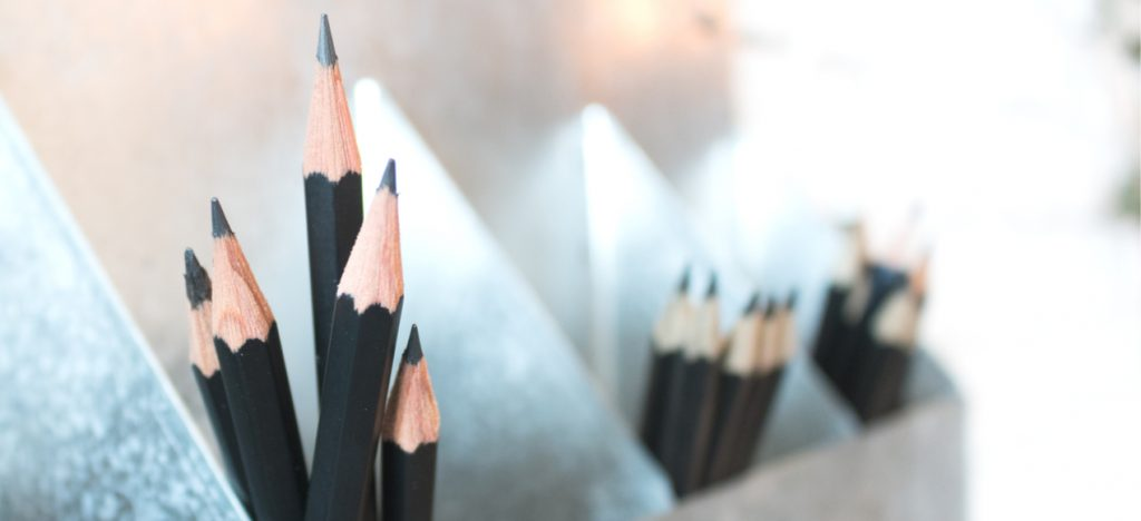 tins filled with black pencils
