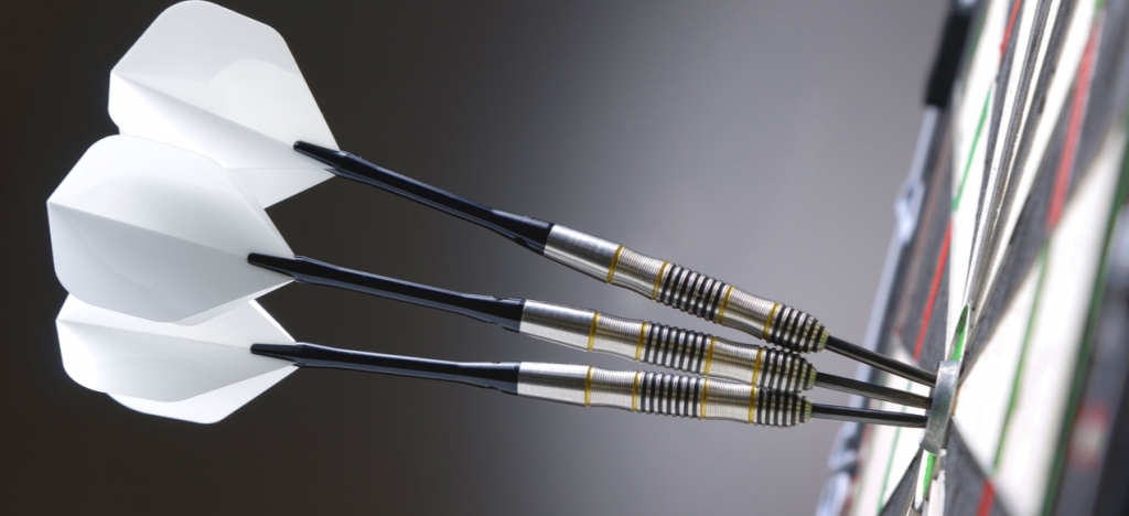 three white darts in a bullseye